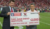 Tommy Espinoza received donation for San Juan Diego Institute