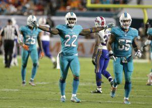 El cornerback de Miami Jamar Taylor (22) reacciona tras contener la ofensiva de los Bills. Foto: AP