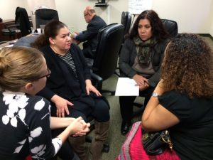 Layla Sulieman Gonzalez, Executive Director, Illinois Latino Family Commission, taking notes during her conversation with Katia Nuques and Docia Buffington of Enlace and Sol Flores of La Casa Norte after the presentation by Raza Development Fund. Foto: Mixed Voces