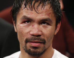 Manny Pacquiao, from the Philippines, waits after the welterweight title fight against Floyd Mayweather Jr., on Saturday, May 2, 2015 in Las Vegas.  (AP Photo/John Locher)