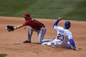 Los Angeles Dodgers' Adrian Gonzalez, right, takes second on a wild pitch as Arizona Diamondbacks second baseman Chris Owings takes a late throw from home during the fourth inning of a baseball game, Sunday, May 3, 2015, in Los Angeles. (AP Photo/Mark J. Terrill)