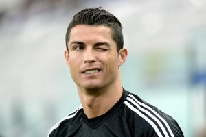 Real Madrid's Cristiano Ronaldo winks during a training session ahead of Tuesday's Champions League semifinal first leg soccer match between Juventus and Real Madrid, at Turin's Juventus Stadium, Italy, Monday, May 4, 2015. (AP Photo/Massimo Pinca)