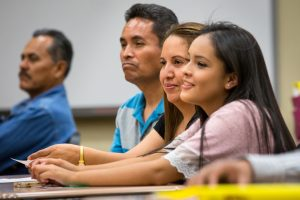"""20150506 – ASU News – Dream Academy – Jamie and Patricia Fabian, along with their 15-year-old daughter Yenifer, attend the American Dream Academy, at Trevor Browne High School in Phoenix, on Wednesday, May 6, 2015. The program is a free, 10-week """"parent empowerment program"""" for Latinos to inform parents about the requirements for college and different ways of paying for it. The Fabians are the 30,000th parents to complete the program. They have a son, Jaime Jr., 19, who already attends ASU. The school principal, Dr. Gabriel Trujillo taught the class. Photo by Charlie Leight/ASU News"""