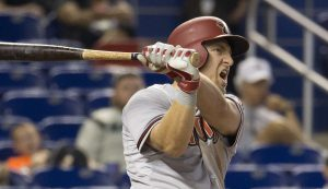 Arizona Diamondbacks' Cliff Pennington (4) reacts after he hit a ball that drove home a run during the sixth inning of a baseball game against the Miami Marlins in Miami, Thursday, May 21, 2015. The Diamondbacks won 7-6, sweeping the series. (AP Photo/J Pat Carter)