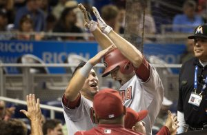 Arizona Diamondbacks'  David Peralta, left, celebrates with A.J. Pollock during the eighth inning of a baseball game against the Miami Marlins in Miami, Tuesday, May 19, 2015, after Pollock hit a go-ahead two-run home run. The Diamondbacks won 4-2. (AP Photo/J Pat Carter)
