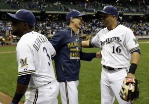 Milwaukee Brewers manager Craig Counsell celebrates with Elian Herrera (3) and Aramis Ramirez (16) after a baseball game against the Los Angeles Dodgers Monday, May 4, 2015, in Milwaukee. The Brewers won 4-3. (AP Photo/Morry Gash)