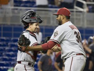 Arizona Diamondbacks catcher Tuffy Gosewisch, left,  and Arizona Diamondbacks relief pitcher Enrique Burgos, right, celebrate after the 13th inning of a baseball game in Miami, Monday, May 18, 2015. The Diamondbacks won 3-2 in the 13th inning. (AP Photo/J Pat Carter)
