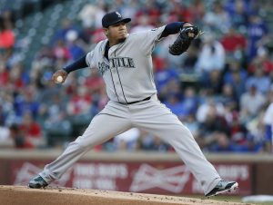 Seattle Mariners' Felix Hernandez delivers a pitch against the Texas Rangers during the first inning of a baseball game, Wednesday, April 29, 2015, in Arlington, Texas. (AP Photo/Tony Gutierrez)