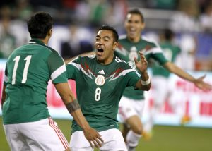 Mexico midfielder Marco Fabian (8) celebrates with Alan Pulido (11) after Pulido scored during the second half of an international friendly soccer match against the U.S. Wednesday, April 2, 2014, in Glendale, Ariz. The game ended in a 2-2 draw. (AP Photo/Rock Scuteri)
