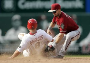 Arizona Diamondbacks second baseman Chris Owings, right, tags St. Louis Cardinals' Peter Bourjos out at second on a steal attempt during the eighth inning of a baseball game Monday, May 25, 2015, in St. Louis. (AP Photo/Jeff Roberson)
