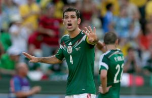 Mexico's Rafael Marquez, left, instructs his teammates after the Netherlands scored their second goal during the World Cup round of 16 soccer match between the Netherlands and Mexico at the Arena Castelao in Fortaleza, Brazil, Sunday, June 29, 2014. (AP Photo/Marcio Jose Sanchez)
