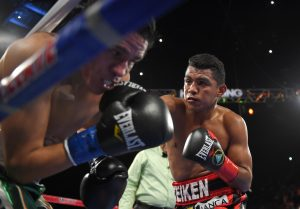 Roman Gonzalez, right, of Nicaragua, connects a right to Edgar Sosa, of Mexico, during a WBC flyweight world championship boxing bout, Saturday, May 16, 2015, in Inglewood, Calif. (AP Photo/Mark J. Terrill)