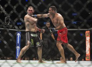 Brazil's Fabricio Werdum lands a punch to United States' Cain Velasquez during a heavyweight mixed martial arts title bout at UFC 188 in Mexico City, Saturday, June 13, 2015. Werdum won the fight by submission. (AP Photo/Christian Palma)