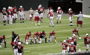 The Arizona Cardinals run drills during an NFL football training camp, Monday, Aug. 11, 2014, in Glendale, Ariz. (AP Photo/Matt York)