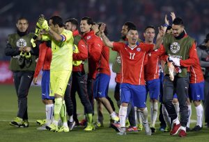 Chile's Gary Medel , center right, celebrates with teammates after a Copa America semifinal soccer match against Peru at the National Stadium in Santiago, Chile, Monday, June 29, 2015. Chile won 2-1.(AP Photo/Ricardo Mazalan)