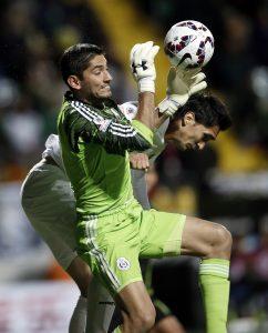 Mexico's goalkeeper Jose de Jesus Corona grabs the ball as Bolivia's Ricardo Pedriel tries a header during a Copa America Group A soccer match at the Sausalito Stadium in Vina del Mar, Chile, Friday, June 12, 2015. (AP Photo/Silvia Izquierdo)