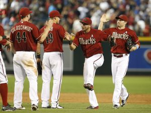 Arizona Diamondbacks left fielder David Peralta and teammates celebrate after defeating the San Diego Padres 7-2 during a baseball game, Sunday, June 21, 2015, in Phoenix. (AP Photo/Rick Scuteri)
