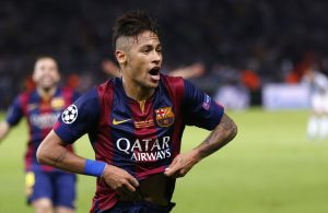 Barcelona's Neymar celebrates after scoring his side's third goal during the Champions League final soccer match between Juventus Turin and FC Barcelona at the Olympic stadium in Berlin Saturday, June 6, 2015. (AP Photo/Michael Probst)