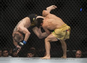 Henry Cejudo, right, battles against Chico Camus, both from the United States ,during a men's flyweight UFC 188 mixed arts bout in Mexico City, Saturday, June 13, 2015. Cejudo won the fight by decision. (AP Photo/Christian Palma)