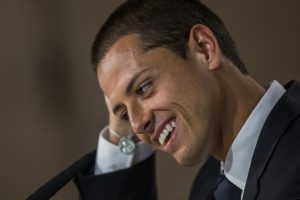 Mexico's international soccer player Javier Hernandez 'Chicharito', gestures at a press conference during his official presentation at the Santiago Bernabeu stadium in Madrid, Spain, Monday, Sept. 1, 2014, after signing for Real Madrid. (AP Photo/Andres Kudacki)