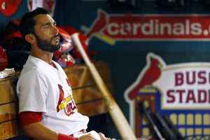 St. Louis Cardinals' Matt Carpenter sits in the dugout during the seventh inning of a baseball game against the Kansas City Royals, Friday, June 12, 2015, in St. Louis. The Cardinals won 4-0. (AP Photo/Billy Hurst)