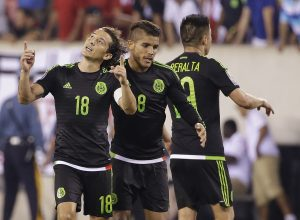 Mexico's Andres Guardado (18) and Jonathan Dos Santos (8) celebrate during the overtime period of a CONCACAF Gold Cup soccer match against Costa Rica Sunday, July 19, 2015, at MetLife stadium in East Rutherford, N.J. Mexico won 1-0. (AP Photo/Seth Wenig)