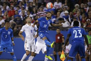 Honduras' Afredo Mejia (19) jumps for the header against U.S. forward Clint Dempsey (8) during the second half of a CONCACAF Gold Cup soccer match in Frisco, Texas, Tuesday, July 7, 2015. Looking on are Honduras' Carlos Discua (7) and Johnny Palacios. The U.S. won 2-1. (AP Photo/LM Otero)