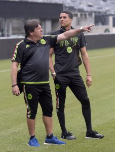 Mexico coach Miguel Herrera, left, and goalkeeper Guillermo Ochoa check out the pitch at MetLife Stadium for Sunday's Gold Cup soccer match against Costa Rica, Saturday, July 18, 2015, in East Rutherford, N.J. (AP Photo/Bill Kostroun)