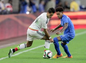 Mexico's Javier Hernandez, left, attempts to take the ball from Honduras' Henry Figueroa (5) during the first half of a soccer match Wednesday, July 1, 2015, in Houston. (AP Photo/Bob Levey)
