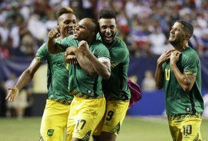 Jamaica's Michael Seaton, Rudolph Austin, Giles Barnes and Joel McAnuff, from left, celebrate after Jamaica defeated the United States 2-1 in a CONCACAF Gold Cup soccer semifinal Wednesday, July 22, 2015, in Atlanta. (AP Photo/David Goldman)
