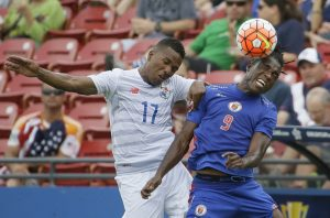Haiti forward Kervens Belfort (9) and Panama defender Luis Henriquez (17) jump for a head ball during the first half of a CONCACAF Gold Cup soccer match in Frisco, Texas, Tuesday, July 7, 2015. (AP Photo/LM Otero)