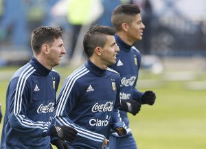 Argentina's Lionel Messi, from left, Sergio Aguero, and Marcos Rojo, jog during a training session in Concepcion, Chile, Wednesday, July 1, 2015. Argentina defeated Paraguay 6-1 on Tuesday and will face Chile in the final of Copa America soccer tournament Saturday. (AP Photo/Andre Penner)