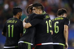 Mexico forward Oribe Peralta, right, celebrates scoring a goal against Cuba with midfielder Jonathan Dos Santos, left, during the first half of a CONCACAF Gold Cup soccer match, Thursday, July 9, 2015, in Chicago. Mexico won 6-0. (AP Photo/Andrew A. Nelles)