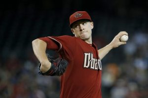 Arizona Diamondbacks' Patrick Corbin throws a pitch against the San Francisco Giants during the first inning of a baseball game Sunday, July 19, 2015, in Phoenix. (AP Photo/Ross D. Franklin)