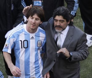 Argentina head coach Diego Maradona, right, and Argentina's Lionel Messi, left, walk off the pitch after winning the World Cup group B soccer match between Argentina and South Korea at Soccer City in Johannesburg, South Africa, Thursday, June 17, 2010. Argentina won 4-1.  (AP Photo/Marcio Jose Sanchez)