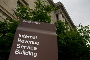 A sign for the Internal Revenue Service (IRS) stands in front of it's headquarters in Washington, D.C., U.S., on Wednesday, May 15, 2013. The widening inquiries into the IRS are focusing less on why employees singled out small-government groups for scrutiny and more on agency executives who didn't inform Congress earlier. Photographer: Andrew Harrer/Bloomberg ORG XMIT: 168943858