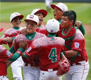 Mexico's Gerardo Lujano, second from left, celebrates with teammates after getting the final out of an International elimination baseball game against Venezuela at the Little League World Series tournament in South Williamsport, Pa., Thursday, Aug. 27, 2015. Mexico won 11-0. (AP Photo/Gene J. Puskar)