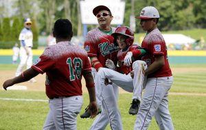 Mexico's Jorge Armenta, second from right, is carried off the field by Isaac Sanchez, right, and Armando Verdugo, second from left, after Armenta's home run during the third inning of an International elimination baseball game against Australia at the Little League World Series, Monday, Aug. 24, 2015, in South Williamsport, Pa. Mexico won 14-3 in four innings. (AP Photo/Matt Slocum)
