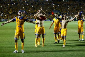 Players of Mexico's Tigres celebrate their 3-1 victory over Brazil Internacional at the end of their Copa Libertadores semi-final soccer match in Monterrey, Mexico, Wednesday, July 22, 2015. Tigres will face Argentina's River Plate in the final. (AP Photo/Alfredo Lopez)