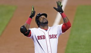 Boston Red Sox designated hitter David Ortiz raises his arms and looks upward as he crosses home plate after a two-run home run during the first inning of a baseball game against the Tampa Bay Rays at Fenway Park in Boston, Thursday, Sept. 24, 2015. (AP Photo/Charles Krupa)