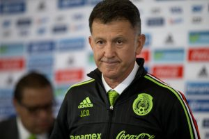 Juan Carlos Osorio, newly-appointed head coach of Mexico's national soccer team, wears his team jacket after being presented with it, at a press conference in Mexico City, Wednesday, Oct. 14, 2015. (AP Photo/Rebecca Blackwell)