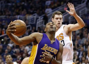 Los Angeles Lakers' Metta World Peace, left, gets fouled as he goes up for a shot as Phoenix Suns' Jon Leuer, right, defends during the first half of an NBA basketball game Monday, Nov. 16, 2015, in Phoenix. (AP Photo/Ross D. Franklin)