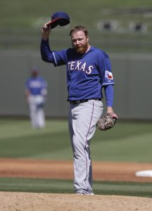 Texas Rangers' Tommy Hanson in action during a spring exhibition baseball game against the Kansas City Royals Saturday, March 22, 2014, in Surprise, Ariz. (AP Photo/Darron Cummings)