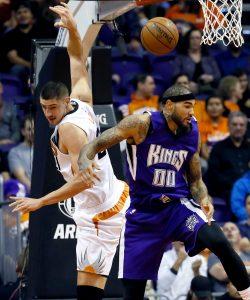 Sacramento Kings' Willie Cauley-Stein (00) and Phoenix Suns' Alex Len loses the ball during the first half of an NBA basketball game, Wednesday, Nov. 4, 2015, in Phoenix. (AP Photo/Matt York)
