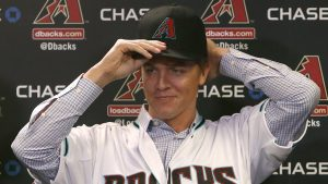 Arizona Diamondbacks pitcher Zack Greinke talks to the media during a press conference, Friday, Dec. 11, 2015, in Phoenix. Greinke could have stayed with the Los Angeles Dodgers or gone up the coast to the San Francisco Giants. Instead, he signed a massive contract with the Arizona Diamondbacks, dramatically shifting the landscape in the NL West.   (AP Photo/Rick Scuteri)