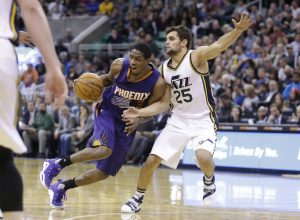 Phoenix Suns guard Brandon Knight (3) drives around Utah Jazz guard Raul Neto (25) during the second half of an NBA basketball game Monday, Dec. 21, 2015, in Salt Lake City. The Jazz won 110-89. (AP Photo/Rick Bowmer)
