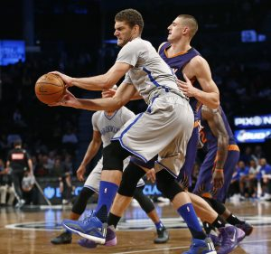 Brooklyn Nets center Brook Lopez (11) backs into the paint with Phoenix Suns center Alex Len (21) defending in the second half of an NBA basketball game at the Barclays Center, Tuesday, Dec. 1, 2015, in New York. The Nets won 94-91. (AP Photo/Kathy Willens)