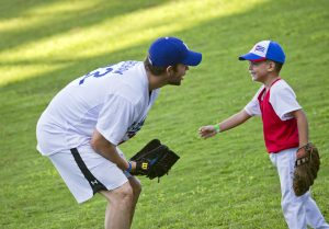 Los Angeles Dodgers pitcher Clayton Kershaw, from the U.S., speaks with a young baseball player during a MBL baseball clinic in Havana, Cuba, Wednesday, Dec. 16, 2015. The three-hour skills camp is part of a three-day mission meant to warm relations between Major League Baseball and Cuba. (AP Photo/Ramon Espinosa)