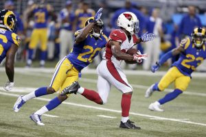 Arizona Cardinals running back Kerwynn Williams, right, runs with the ball as St. Louis Rams cornerback Lamarcus Joyner defends during the third quarter of an NFL football game on Sunday, Dec. 6, 2015, in St. Louis. (AP Photo/Tom Gannam)