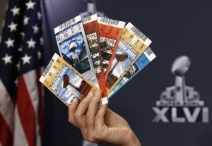 Samples of counterfeit tickets seized from previous NFL Super Bowls are held up by NFL Vice President for Legal Affairs Anastasia Danias during a news conference on counterfeit merchandise in Indianapolis February 2, 2012. The New York Giants will play the New England Patriots in the Super Bowl XLVI on February 5. REUTERS/Jim Young  (UNITED STATES - Tags: SPORT FOOTBALL) - RTR2X7MQ